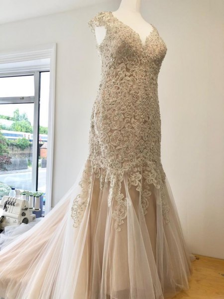 Heavily Beaded champagne wedding