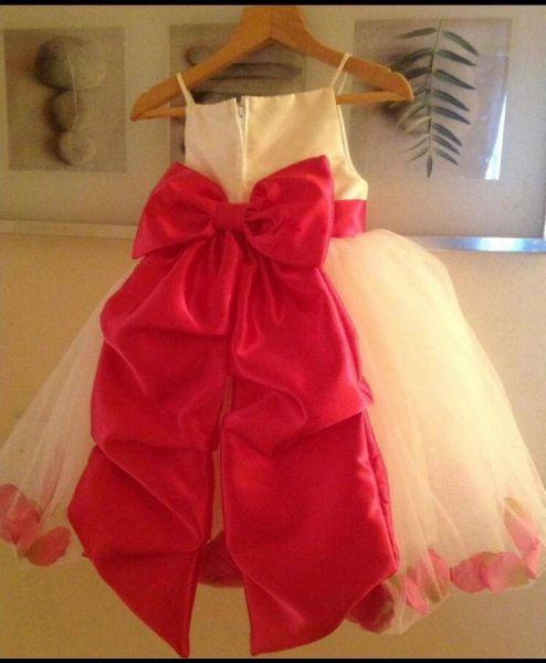Bespoke flower girls dress in satin and tulle fabric.